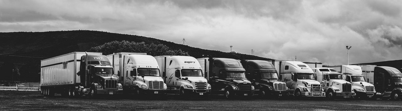 Image of a line of commercial trucks
