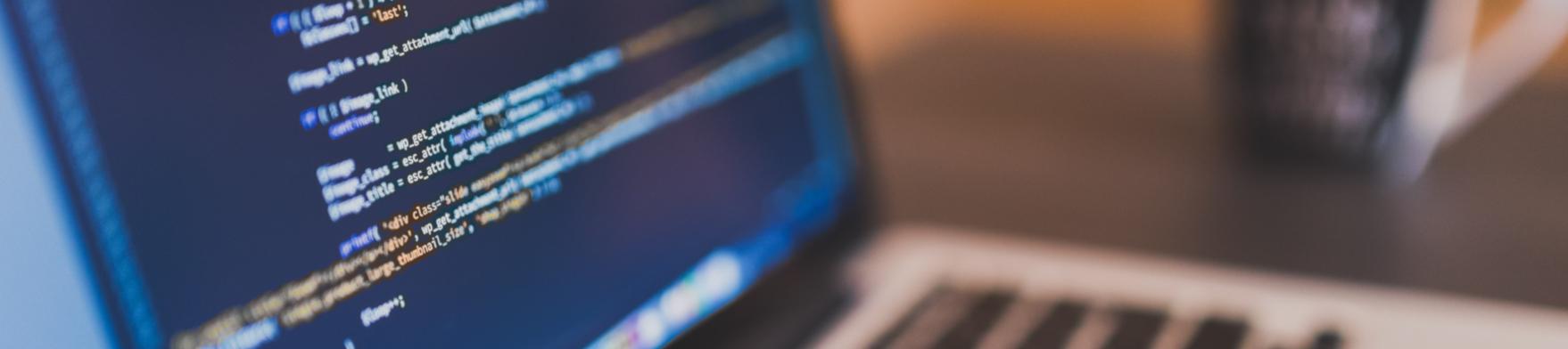 Laptop displaying code.